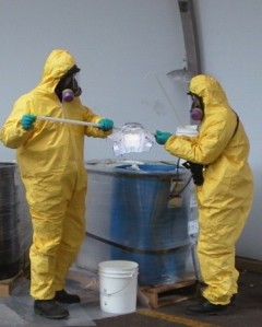 diaper is loaded and sealed into a container by Hazmat team